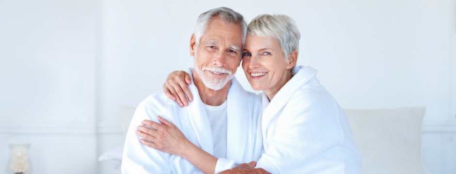 Portrait of a senior old couple having fun together in the bedroom